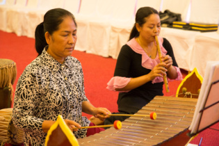 Mr. Nhok Sinat plays Ksa Diew, one-string with hollowed-out gourd instrument and Ms. Men Mao plays Tro Khmer, three-string fiddle.