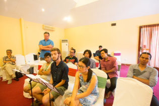 Composers and students are listening performance at rehearsal.