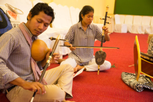 Ms. Ip Theary plays Roneat Ek, Khmer xylophone and Ms. Yim Chanthy plays Khloy, Khmer flute.